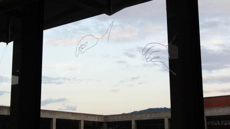 """「空を織る」/ """"weave the sky"""", 2013, yarn on window"""
